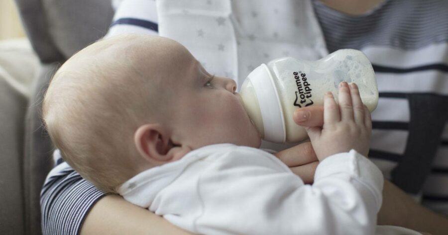 baby feeding from tommee tippee closer to nature bottle