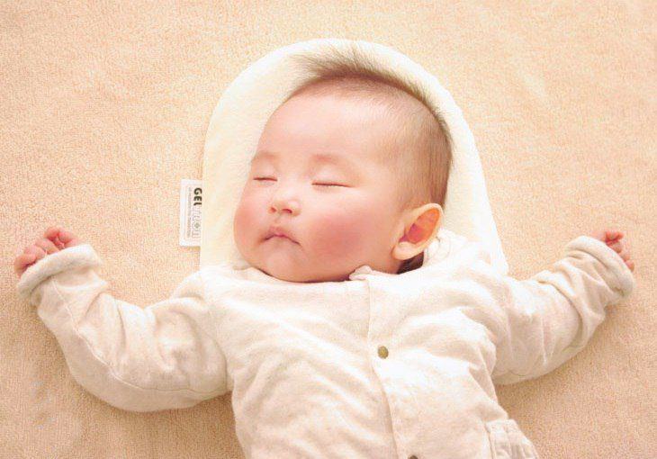 sleeping baby with geltron pillow